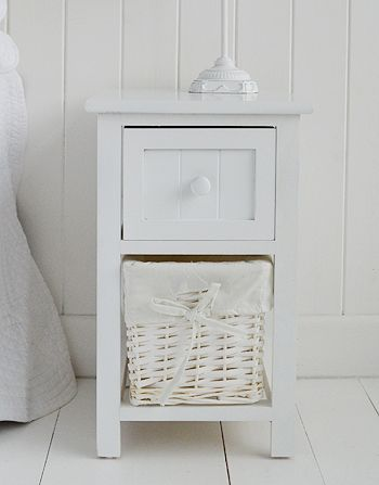 Close view of Bar Harbor small white bedside table with basket storage