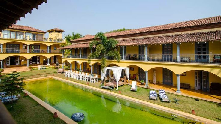 Lovely colonnades by the pool at Sur La Mer, north Goa. In a typically vibrant Goan colour - mustard yellow. To enquire or book: https://www.tripzuki.com/hotels/sur-la-mer-goa/