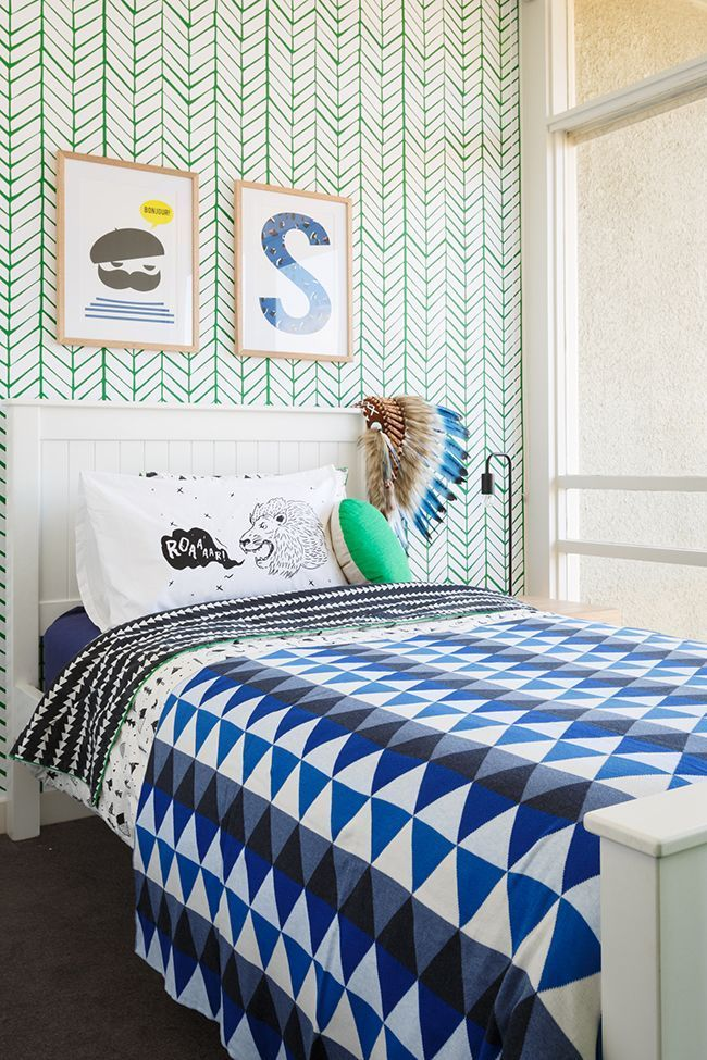 Like the mix of the green pattern of the wall with the blue pattern bedding Also like the wooden frames