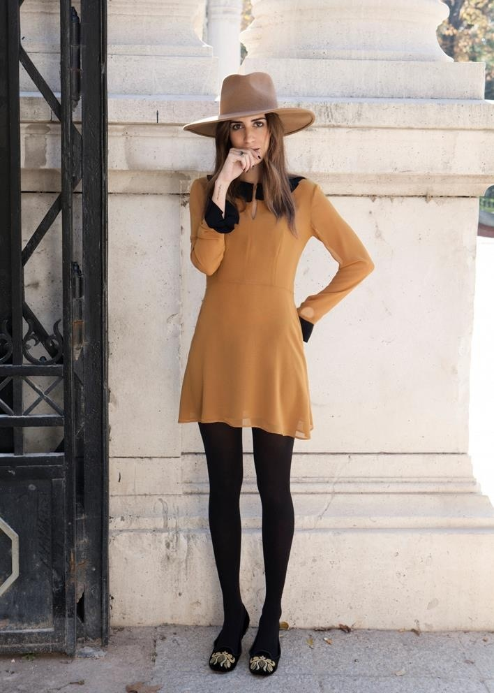 The hat and dress and tights.not the shoes. the dress color and tights  perfect.the hat perfect.the shoes.we'll go shopping.