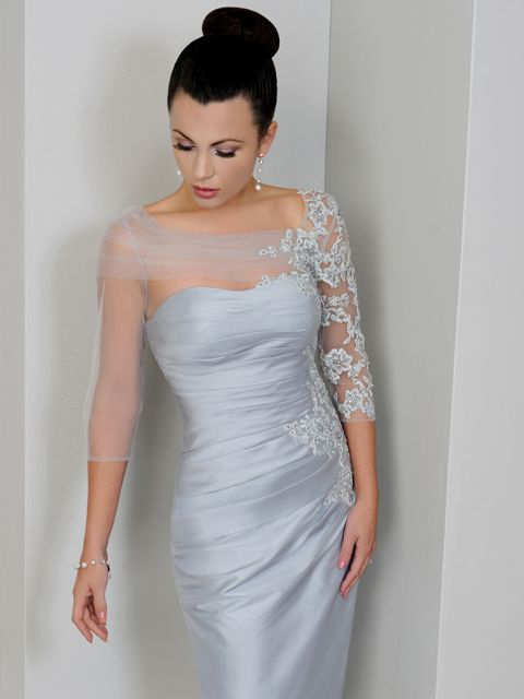 (This would make a gorgeous wedding dress!) This beautiful Irresistible dress has a silk effect fabric with beautiful embellishment on the lace organza sleeves. In a grey/silver shade of colour, this dress is elegant and feminine. Product code IR1275. View more Mother of the Bride / Groom dresses from our Irresistible collection at: http://www.baroqueboutique.co.uk/mother-of-the-bride-south-wales/ Photographs courtesy of: http://www.irresistibleuk.com/