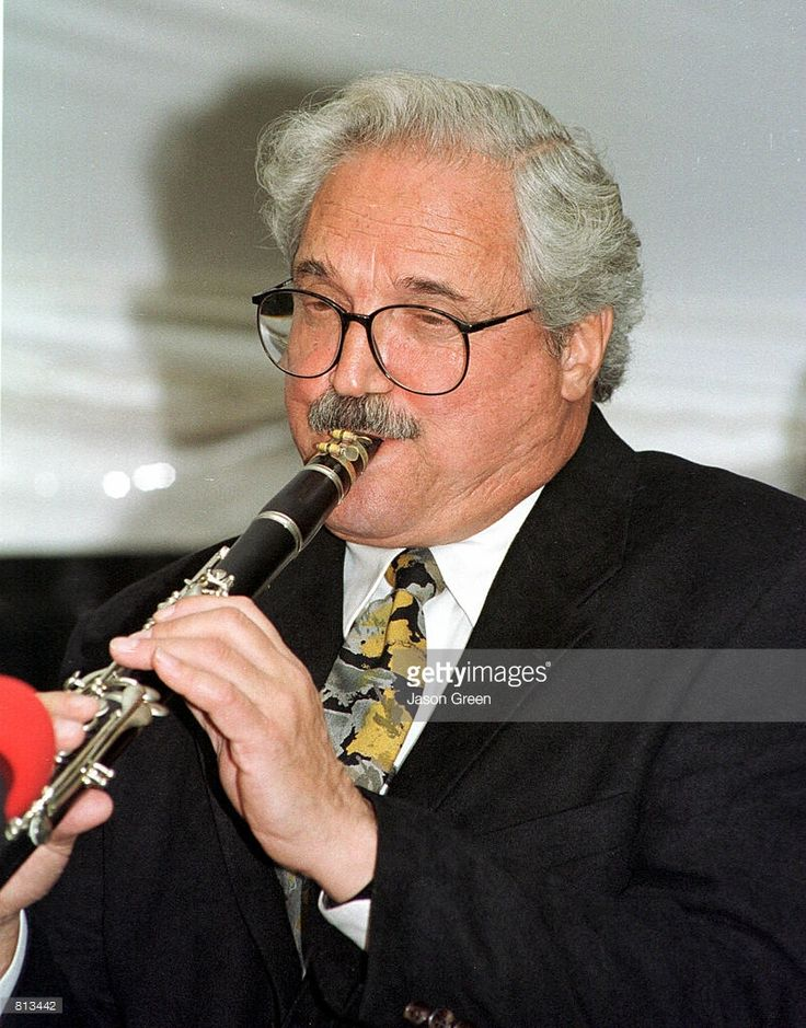 Actor Hal Linden shows off his musical talent playing the ...