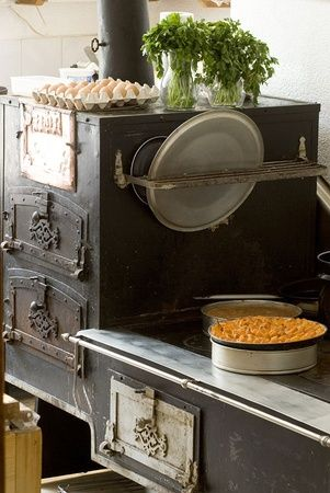 Rustic kitchen, wood burning stove - photography by Stefano Scatà