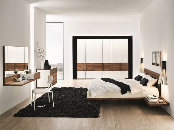secto 4230 wall lights by secto design framing a beautiful wooden bed by austrian brand team7. Black Bedroom Furniture Sets. Home Design Ideas