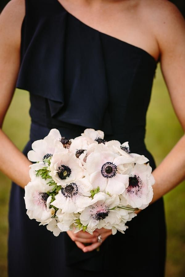 navy dresses mixed beautifully with a bouquet full of anemones   Photography by carolineplusben.com,Floral Design by bellafloraofdallas.com