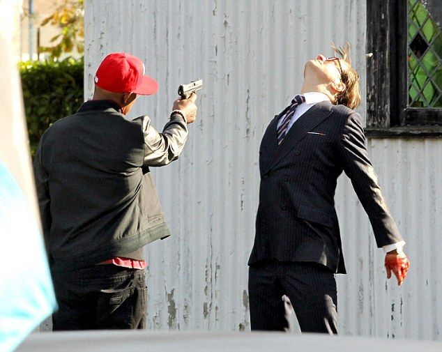 Action shot: Colin Firth and Samuel L Jackson film the final scenes of their latest movie 'The Secret Service' at a church in the south of England