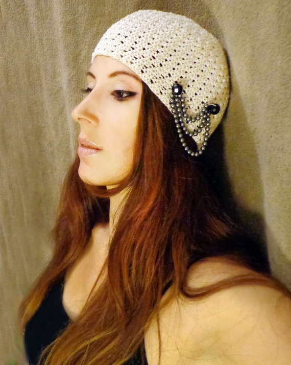 100% Greek Mercerized Cotton, Handmade Crochet White Creme Beanie Hat, with Genuine Swarovski pearls in grey color and Black Onyx natural Gemstones.    This hat is very cute and chic. You can wear it going out, daily, or even to a show or a party!