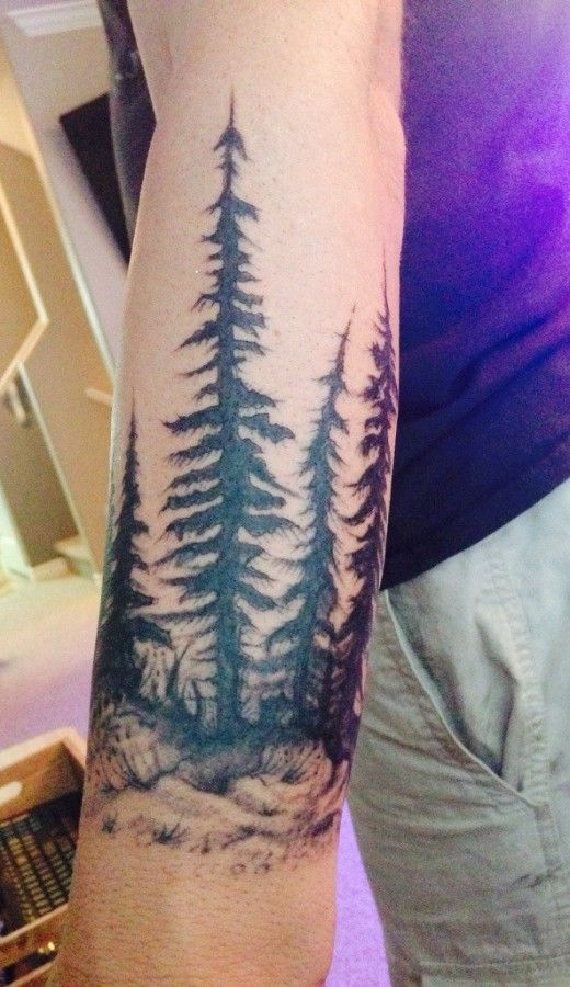 forest sleeve tattoo on forearm