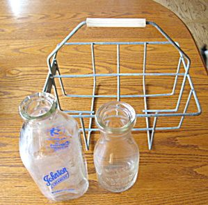 Vintage United Dairy Farmers milk carrier with 2 vintage milk bottles for sale at More Than McCoy on TIAS! Hundreds of vintage pirmitives and dairy items for sale on-line in my shop! Visit soon!