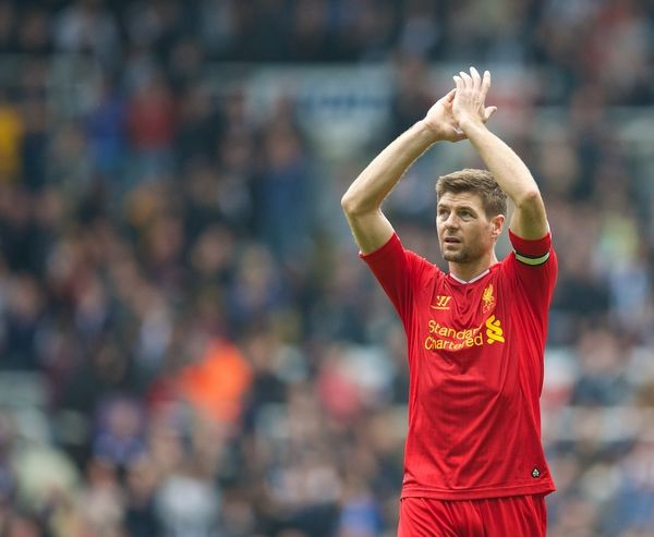 NEWCASTLE-UPON-TYNE, ENGLAND - Saturday, October 19, 2013: Liverpool's captain Steven Gerrard applauds the travelling supporters after his sides' 2-2 draw with Newcastle United during the Premiership match at St. James' Park. (Pic by David Rawcliffe/Propaganda)