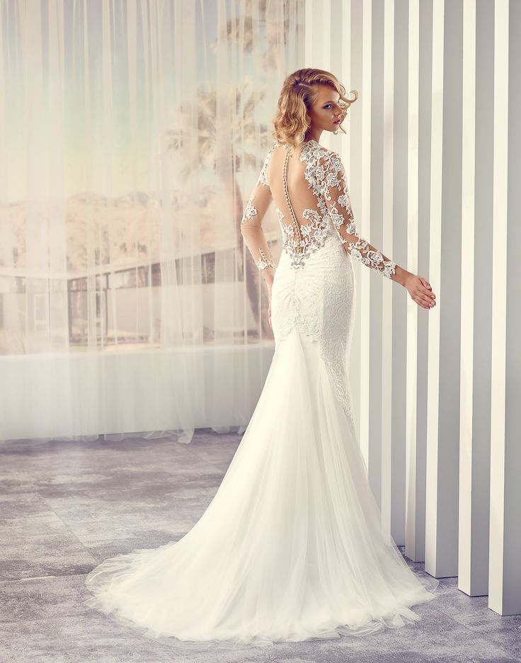 SUKI // Radiating pure elegance with a double layer of Alençon lace appliques over soft Venice lace, and complemented by a deep sweetheart neckline and delicate floral embellishment – this wedding dress is sure to turn heads on your Big Day!