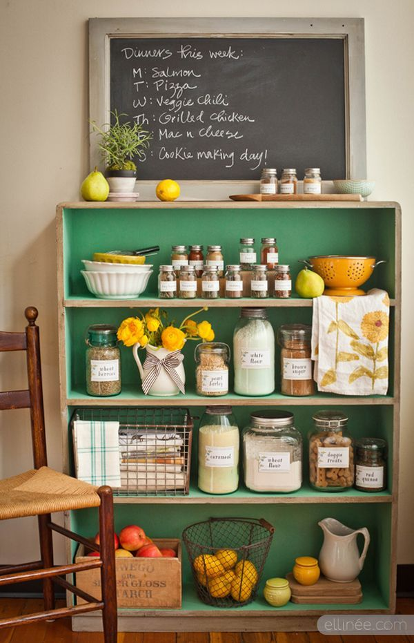 Bring in other furniture that can serve double-duty in the kitchen – a painted bookshelf, for example, adds color and storage for an unused kitchen wall.