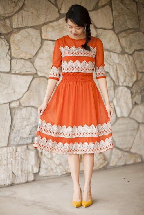 I simply LOVE this orange dress, and the lace accents