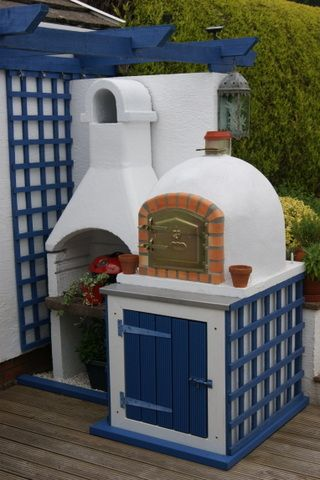 BRICK PIZZA WOOD FIRED BURNING OVEN OUTDOOR GARDEN BARBECUE *AMIGO OVENS** This is currently for sale on Ebay UK. I love it.