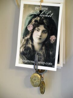 Inspired by days gone by lockets once admired during the Victorian days.  A bronze colored vintage inspired locket hangs from a hand dyed silk ribbon with an adjustable knot closure. Inside the locket, pure lavender perfume. Dab the perfume on pulse points. A complimentary perfume re-fill comes with the locket. Locket re-fills are also available. Hand dyed silk ribbon comes in a variety of muted colors.