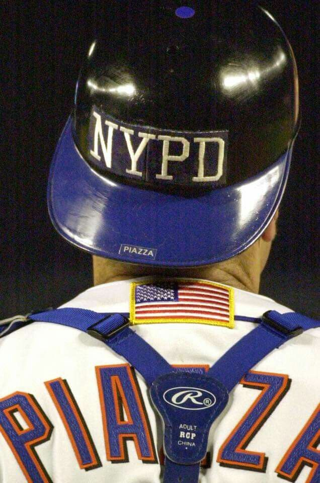 Mike Piazza's helmet honored New York's first responders.   He'd go on to hit an iconic HR for the Mets that same game.