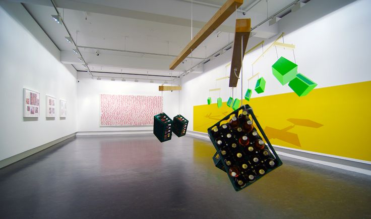 "Jan Christensen ""Interrupted Space Continuum (#1)"", 2010. Plug, hook, wood, ropes, 4 cases of bottled drinks Variable height (370 cm.), 250 x 125 cm. long beams  Jan Christensen ""Interrupted Space Continuum (#3)"", 2011 Wallpainting, acrylic paint Variable dimensions (382 x 970 cm.)  Installation view: Sørlandets Kunstmuseum (#SKMU), #Kristiansand, 2011 #sørlandetskunstmuseum"