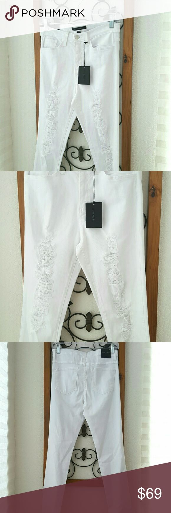 """NEW! Flying Monkeys White Distressed Jeans Super comfy, stretchy and soft material. Mid rise. New with tags. Skinny leg. Inseam: 31"""". Made in USA. Material: cotton, rayon and polyester. Flying Monkey Jeans Skinny"""