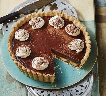 Lace this classic banana and toffee pie with a little dark rum. Top with whipped cream and chocolate.