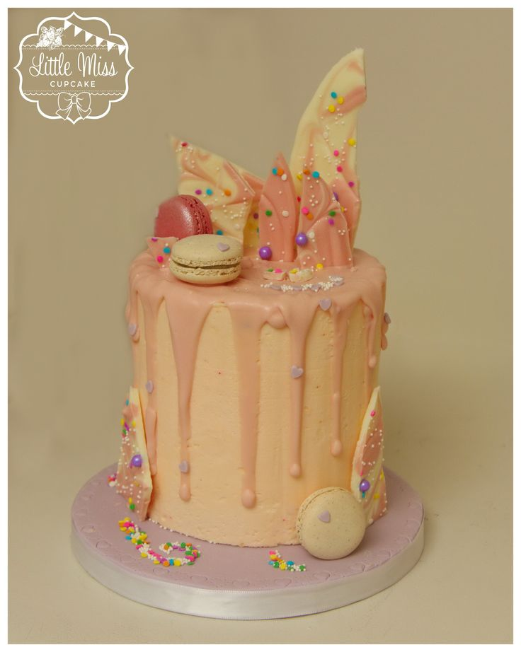 Unicorn poop cake. Unicorn bark. Macarons. Drip cake. Candy melts. Sprinkles and glitter. Girly cake. Pink and purple