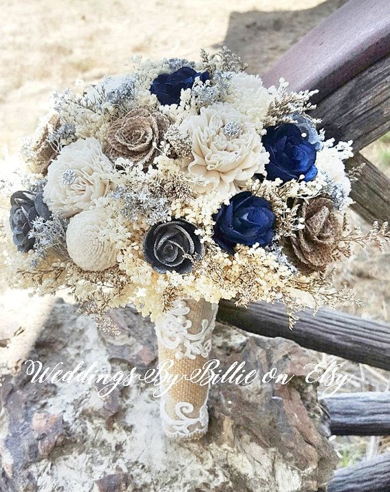 Navy Blue Silver Sola Bouquet, Sola Flowers, Navy Silver Wedding Bouquet, Wedding Flowers, Rustic Shabby Chic, Bridal Accessories, Keepsake ****** Details ******* Beautiful all natural Sola Bouquet. Shown in navy, silver, burlap and ivory. Made with natural ivory sola flowers, navy solas, silver solas, burlap roses, caspia and babies breath. Other colored sola flowers also available-In any color- as I hand dye them myself. This bouquet will last a lifetime! See link below for other color...