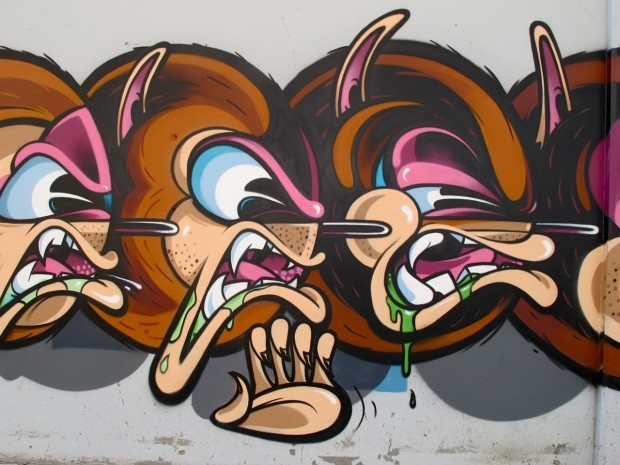 """Graffiti writer Rime has now made a new piece in Cluver City, California. A nice character called """"Super freak 247″ that sneezes. Creative!"""