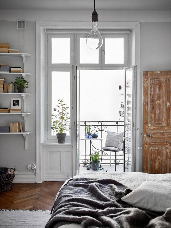 Bedroom Inspiration | Last century wood door amazing windows and balcony. Styling by greydeco