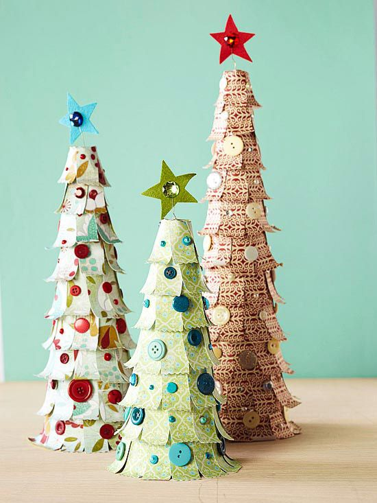 Patterned-Paper Christmas Trees. Cut or punch a decorative edge from 1x2-1/2-inch and 3/4x2-1/2-inch strips of patterned paper; curl the edges by wrapping them around a pencil. Hot-glue the pieces to a foam cone (ours are 9, 12, and 15 inches tall). Top each tree with a star cut from felt and held in place with wire. Add a gem for sparkle. Trim the tree with button, brad, and gem ornaments.