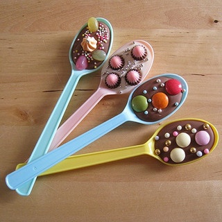 Pour melted candy into spoons, press in cake decorations while warm. Fun kid's party idea.