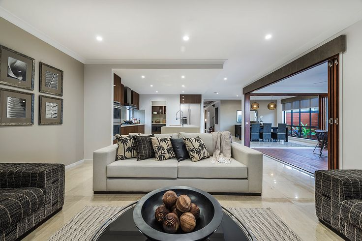 #Living-room #interior #design #inspiration from #Ausbuild's Newbury display home. The soft cream #lounge in this room perfectly complements the multi-toned #coffee-table #ornaments