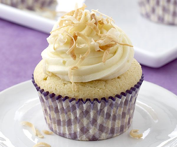 Coconut Snowball Cupcakes have all the flavor of a towering coconut ...
