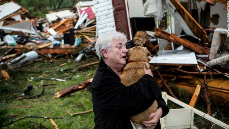 Constance Lambert embraces her dog after finding it when she returned to her tornado-ravaged home in Tupelo, Mississippi, on Monday, April 28. A powerful storm system, including a series of tornadoes, claimed at least three dozen lives in several states.