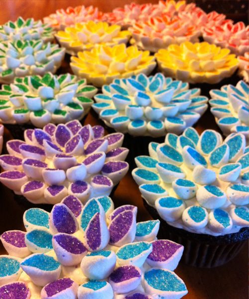 Marshmallow Cupcake toppers.  Cut the marshmellows in half on the diagonal, then toss in a ziplock with colored sugar sprinkles. The sprinkles only stick to the sticky cut side.