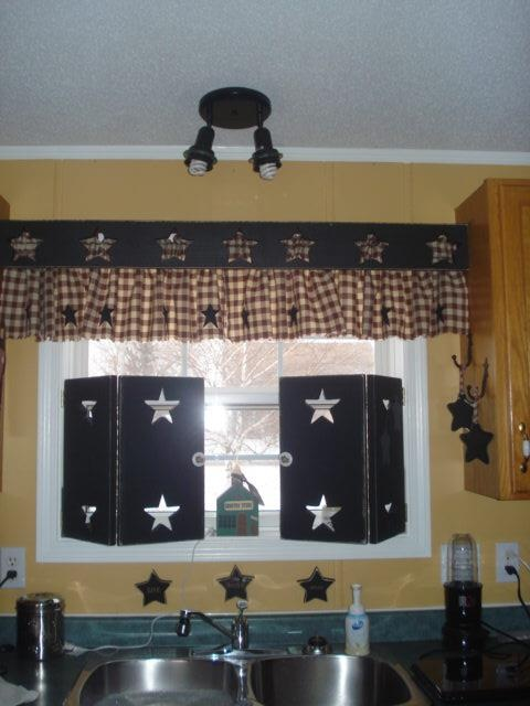 wooden shutters and curtains for kitchen window. Love the wooden shutters with star cut outs!