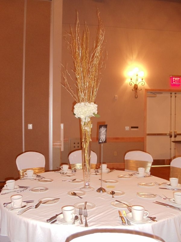 White hydrangea and gold branches tall centerpiece