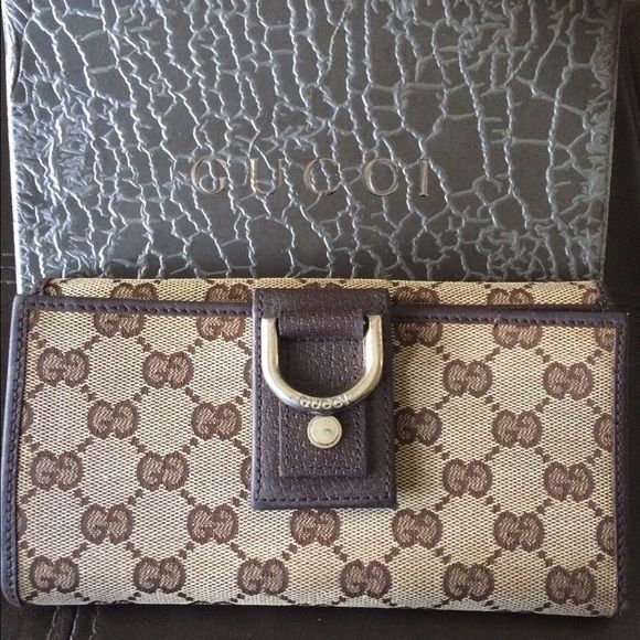 Classic Gucci Wallet Vintage Brown Gucci Wallet  with gold hardware in excellent condition. Has credit card slots and space for check book, and snap on rear for coins. Some sign of wear but just needs a little leather conditioner and age has lots of life left in it. Gucci Bags Wallets