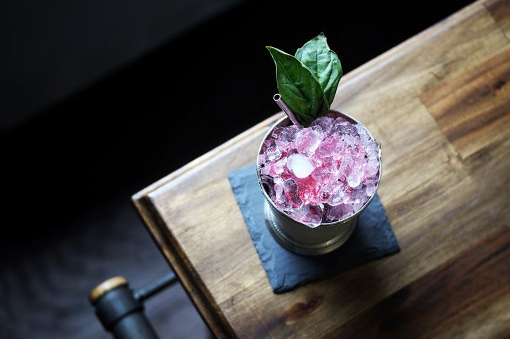 Ingredients: 2oz Mezcal 1oz Cranberry Syrup .25ozAgave Nectar 6 Basil Leaves Basil Sprig Instructions: Add basil leaves and agave nectar to the bottom of a julep cup then muddle gently. Add mezcal...