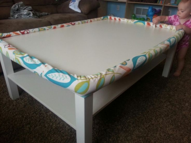 DIY coffee table bumper for under $10: 1. pool noodles from the dollar store. 2. Cut 45º notch out of the noodle. 3. Sew a sleeve and slip over. 4. And stitch closed the two connecting ends.