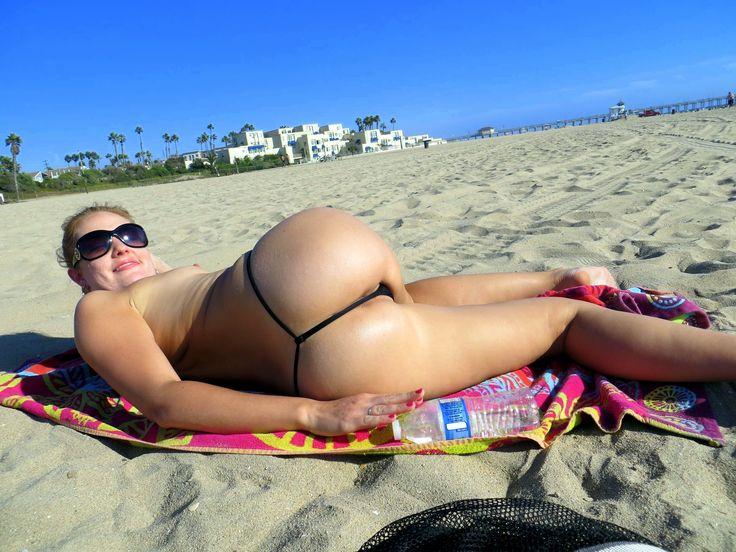 Luscious bikini thongs at the beach Rain