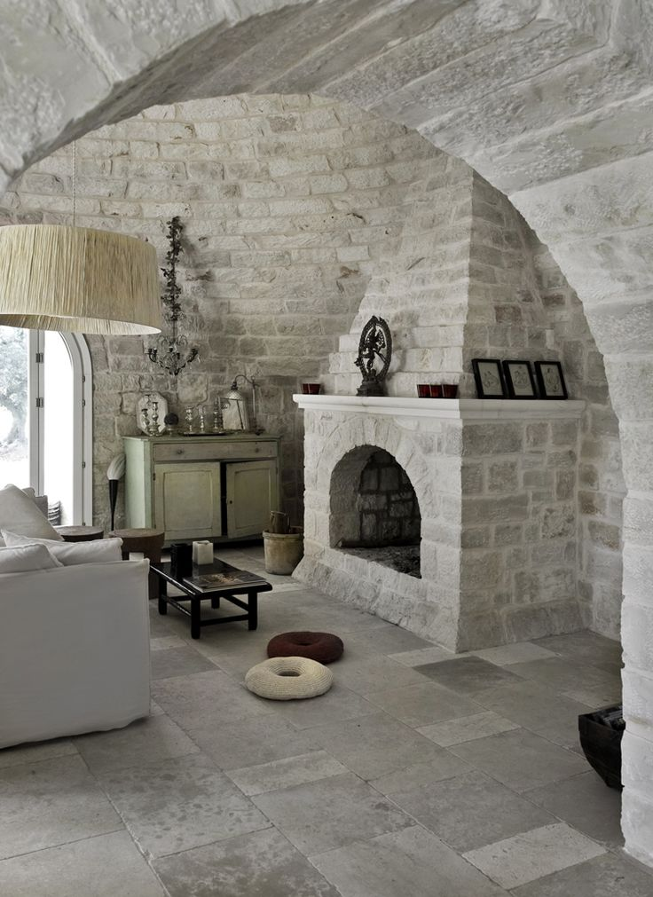 I can't get enough of this washed-out grey color.  It looks so soft and charming.  This is a great interior space, but I'm guessing all the stone makes it pretty chilly when the fire isn't ablaze!