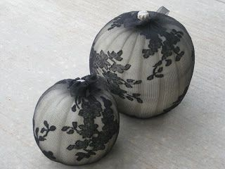 A lace covered white pumpkin adds elegance for upscale Halloween decor.  Photo: beaufleurs.blogspot.com
