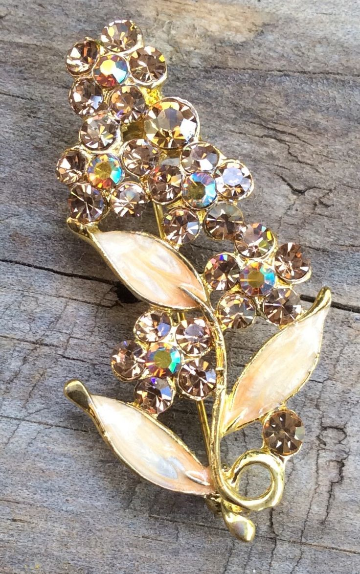 A personal favourite from my Etsy shop https://www.etsy.com/au/listing/562657885/gorgeous-vintage-goldyellow-rhinestone