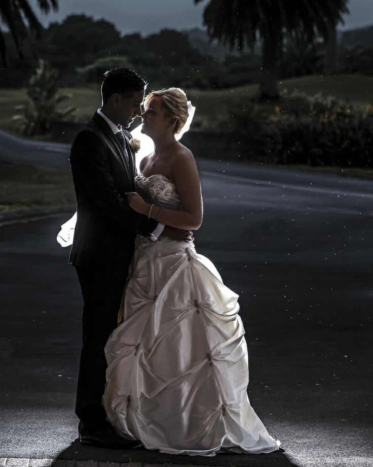 A few rain droplets can go a long way in making beautiful wedding photos.