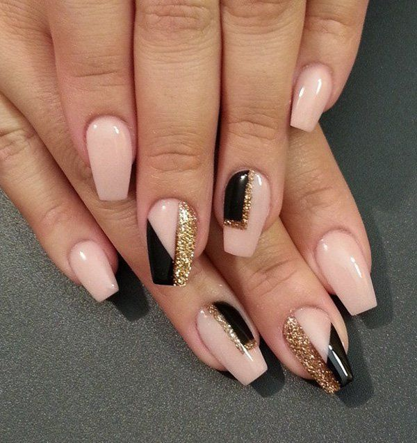 Nude and black abstract nail art design. Add patches of black shapes on top of the nude polish and accentuate the design with patches of gold glitter polish as well to fill up the other side of the nails.