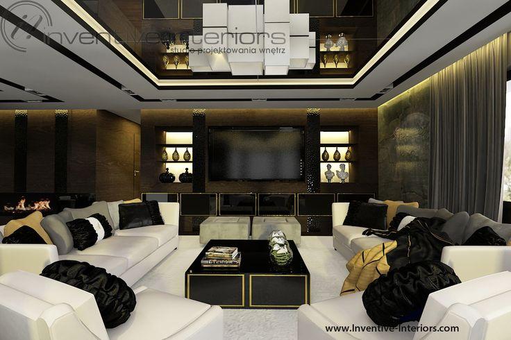 Projekt wnętrz Inventive Interiors - złote akcenty w ciemnym luksusowym salonie