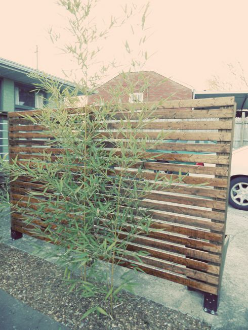 DIY Modern Fence; mount on premade concrete bases, or if the fence is light mount in terra cotta pots with concrete filling.