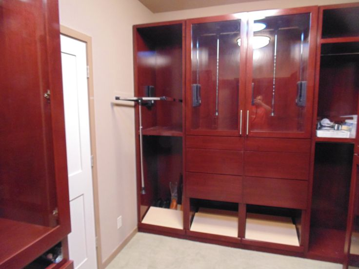 8' high custom master closet with built in drawers, pull out boot & shoe storage plus 3 pull ...