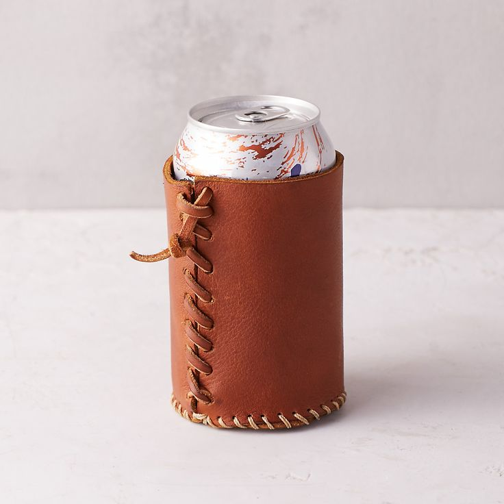 "Keep drinks cool and hands dry with this hand-crafted leather sleeve, each one finished with rustic, stitched details.- Leather- Handmade in the USA4""H, 3.75""D, 2.5"" diameter"