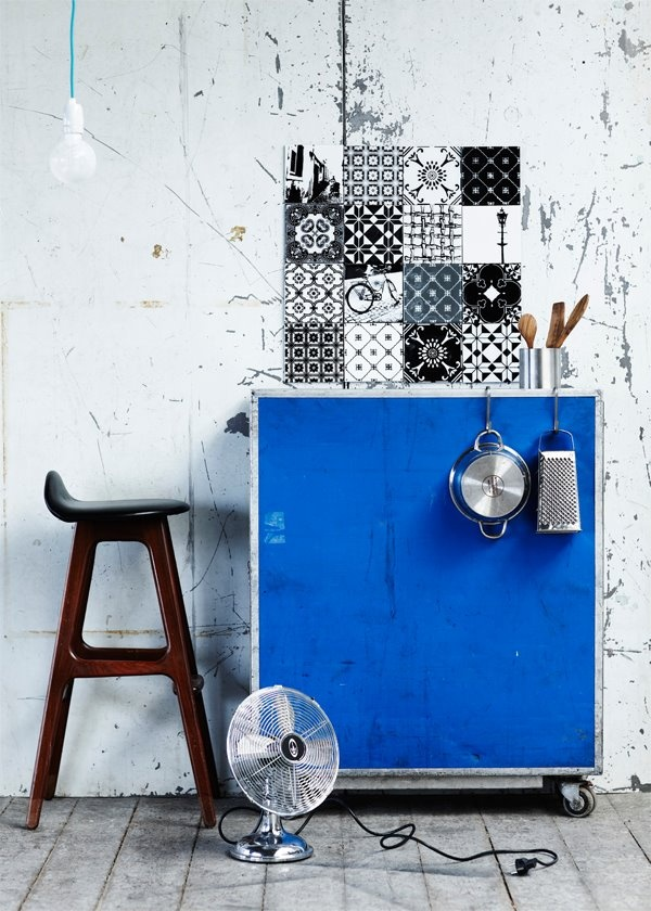cabinet with hooks to organize pots and pans in the kitchen. Paint it bright bright blue against a background of black and white for huge pop of color.