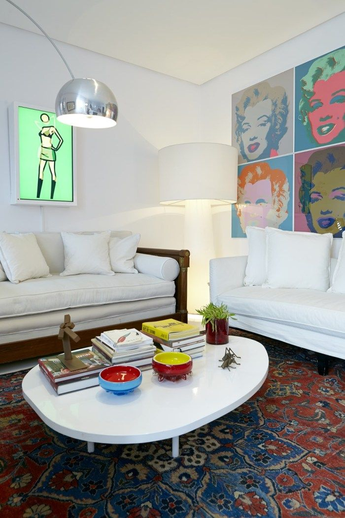 Looking for funky and fun provocative artwork? This small living room wall décor is lined with eclectic pop art, which is a staple in the Madrid high fashion scene. Check out the rest of this fun design at the Mi Casa Blog!